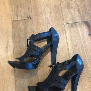 Black Zipper closure heels.  Size 8